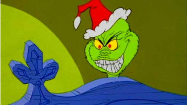 Grinch looking over Cindy Lou Hoo's Bed