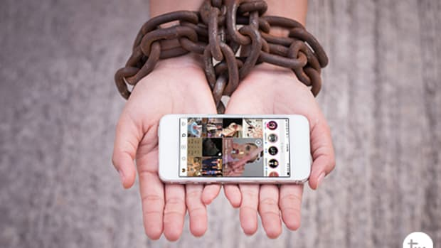 hands-chained-holding-smartphone