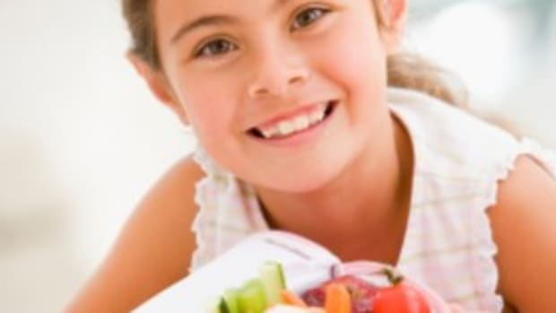 young girl with healthy lunch