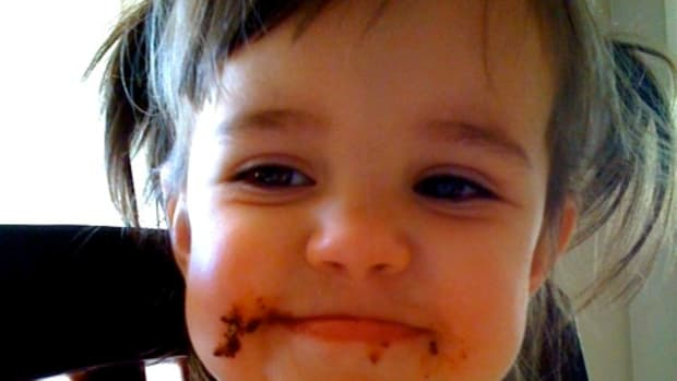 Baby's first cookie face. I posted this on Facebook back in the day, so my family could see that she DOES get treats.