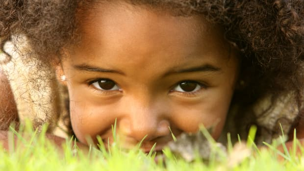 bigstock-Hiding-Child-4403828