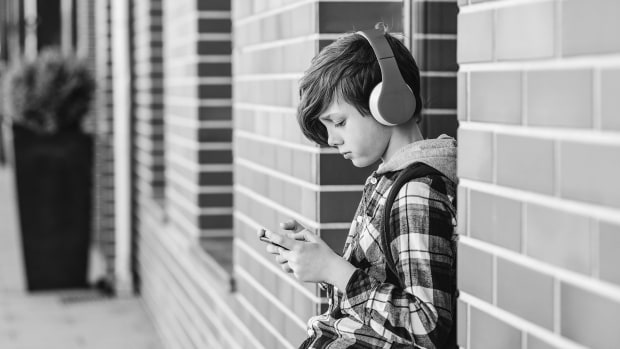 bigstock-Teenage-Boy-Listening-To-Music-303313090