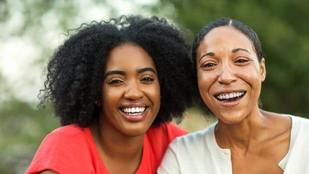 bigstock-African-American-Mother-Huggin-276081586
