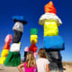 Seven Magic Mountains is a large-scale site-specific public art installation located near Jean Dry Lake and Interstate 15, approximately ten miles south of Las Vegas, Nevada. Comprised of seven towers of colorful, stacked boulders standing more than thirty feet high, Seven Magic Mountains is situated within the Ivanpah Valley adjacent to Sheep Mountain and the McCullough, Bird Spring, and Goodsprings ranges of mountains. A creative expression of human presence in the desert, Seven Magic Mountains punctuates the Mojave with a poetic burst of form and color.More information to plan your stop: SevenMagicMountains.comApril Davis, Today's Mama Editor