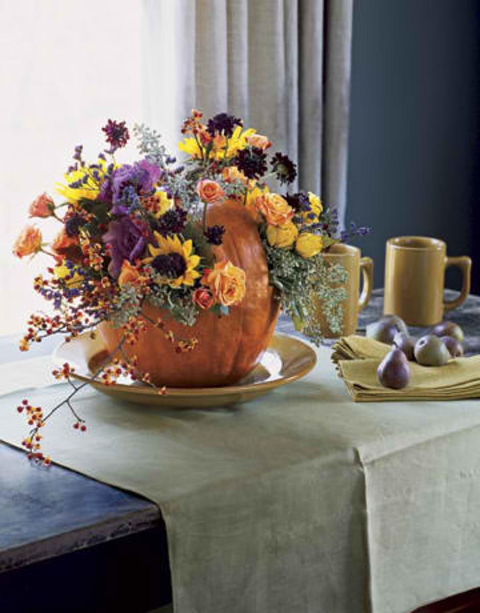 flowers in fresh pumpkin