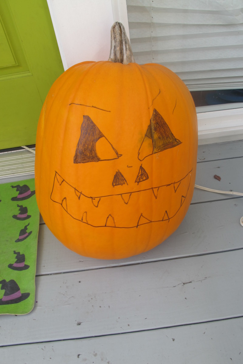 Some kids carve pumpkins. Mine takes a Sharpie to it.