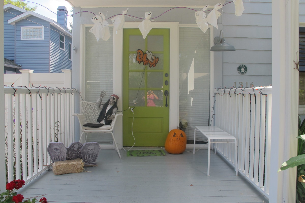 The kid-decorated porch in daylight.
