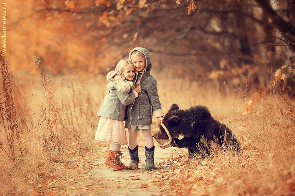 Children photographed with baby bear
