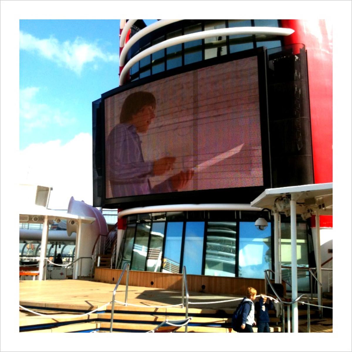 Zac on screen, poolside.