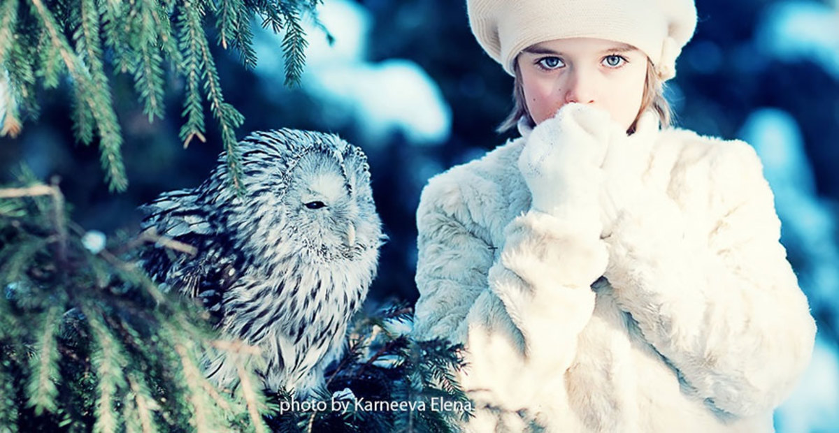 Girl photographed with owl in the winter