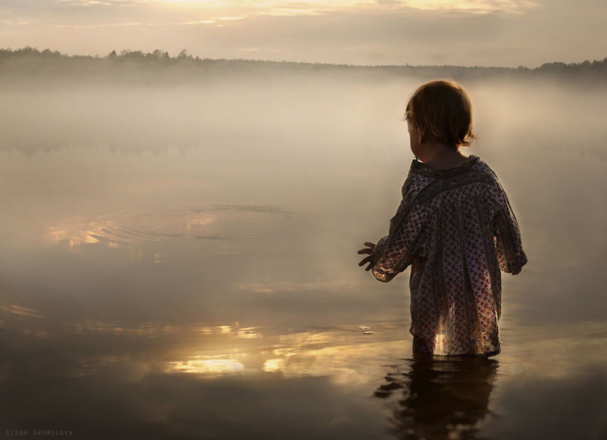 Little girl by the lake