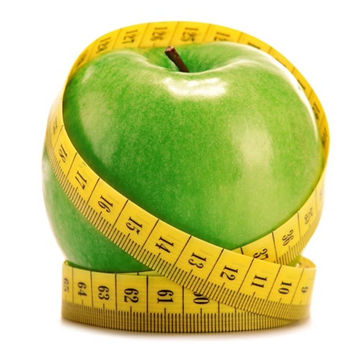 Composition with green apple and tape measure isolated on white background