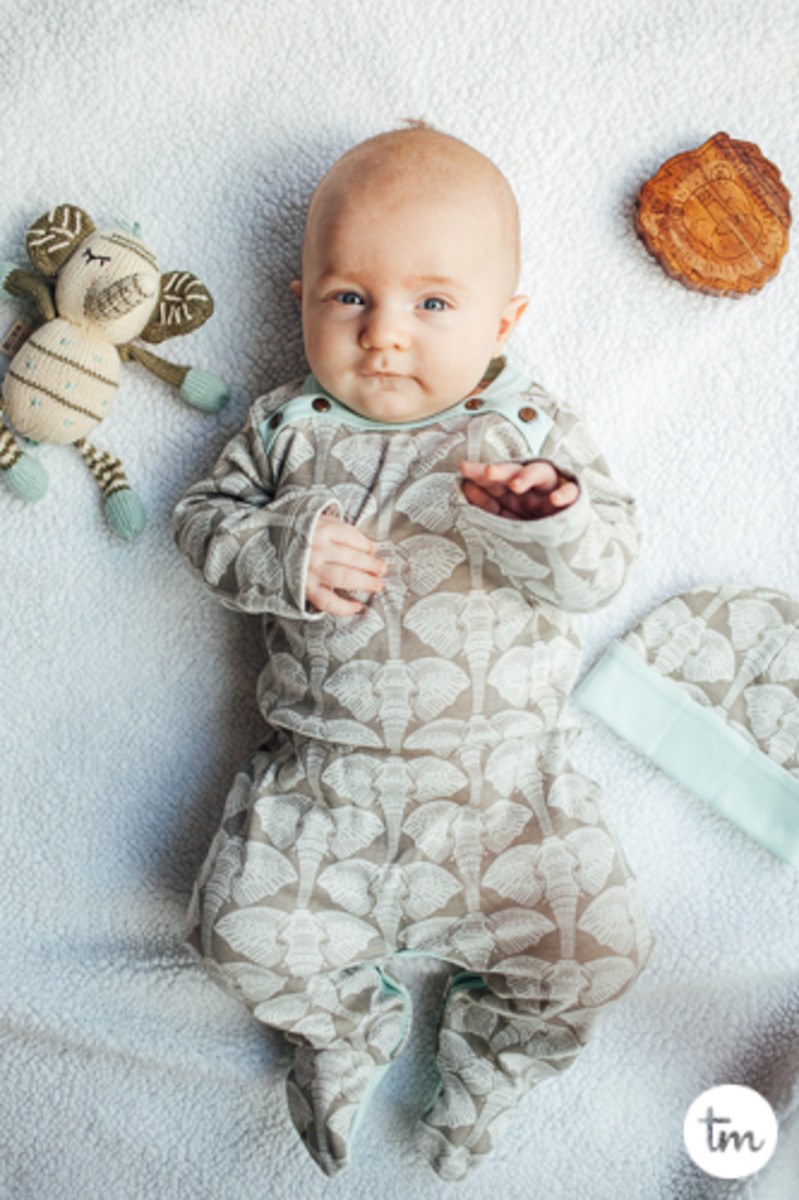baby wearing finn and emma darling pajamas for infants