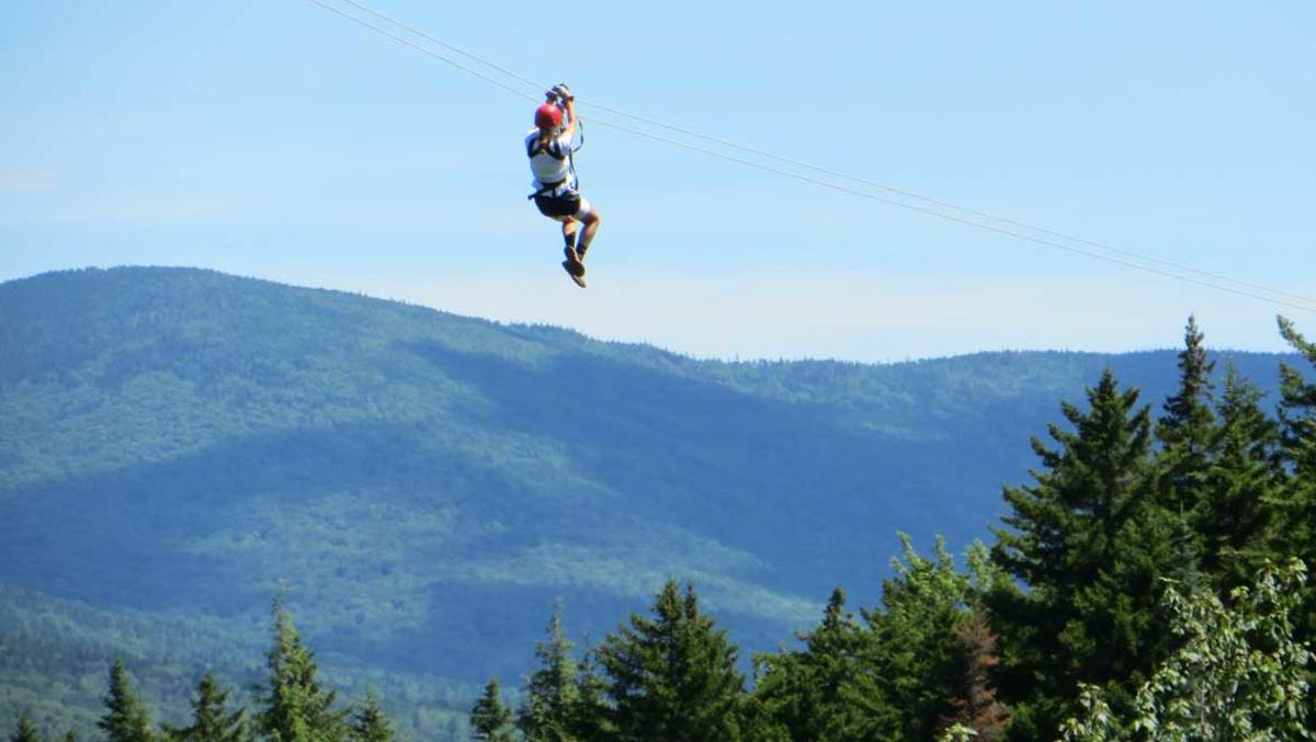 Zip line with Bretton Woods Canopy Tour at Omni Mount Washington Resort. (Courtesy Omni Mount Washington Resort)