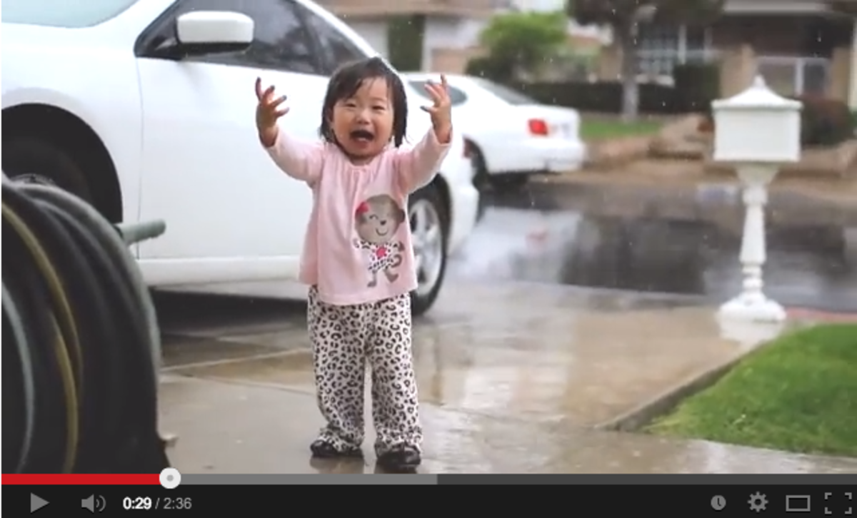 Baby Experiencing Rain for the First Time