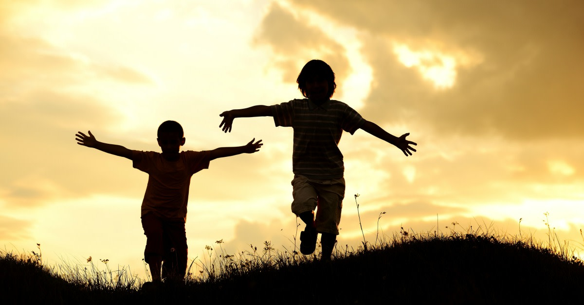active-two-kids-spending-happy-time-on-summer-nature