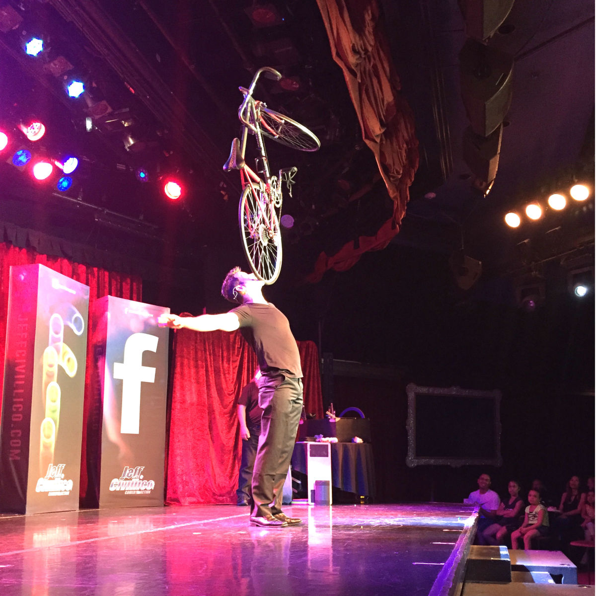 Jeff Civillico balancing a bike on his chin (Photo: Brandi Sjostrom)