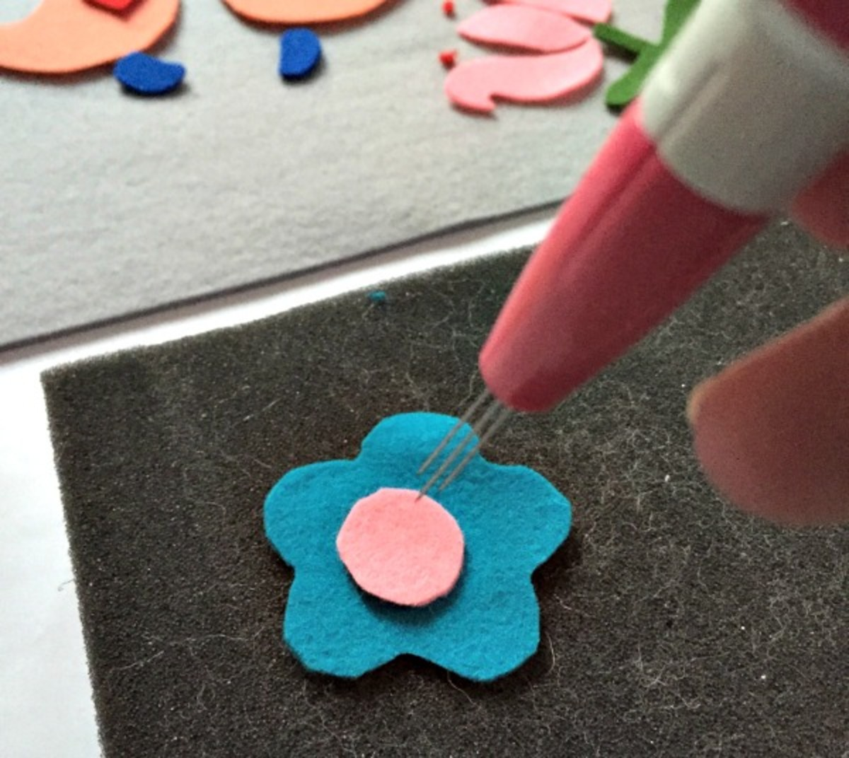 Use a felting needle to blend the pieces together