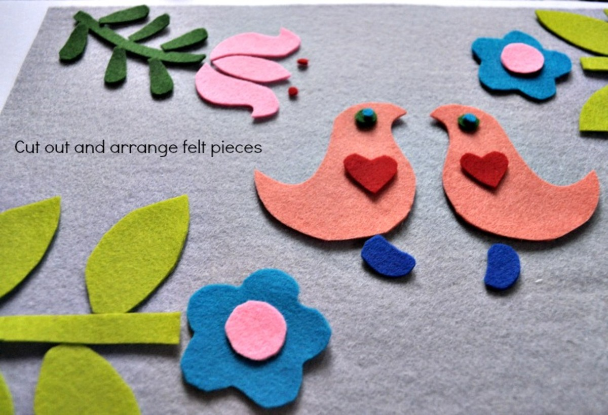Cut out and arrange your design on your background cover piece