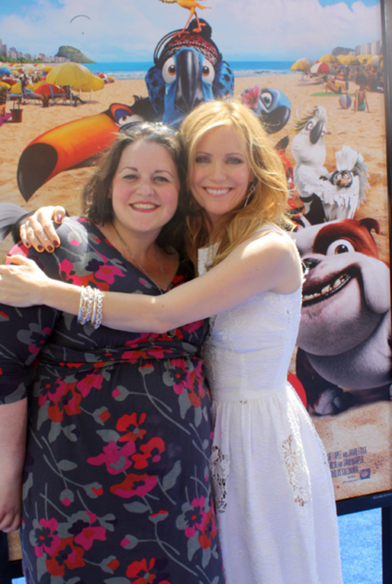 Me, 8 entire months pregnant in Old Navy, with Leslie Mann in D&G