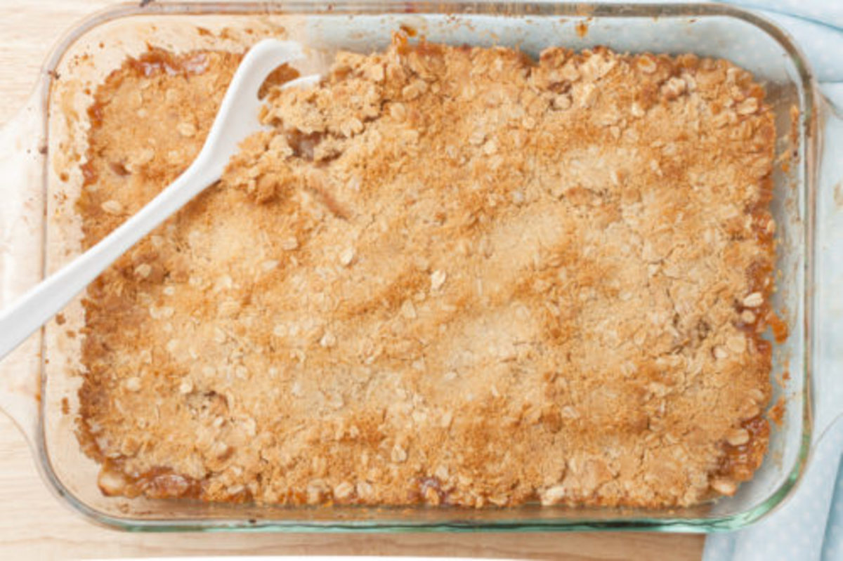 top view of fresh homemade apple crisp in glass baking dish