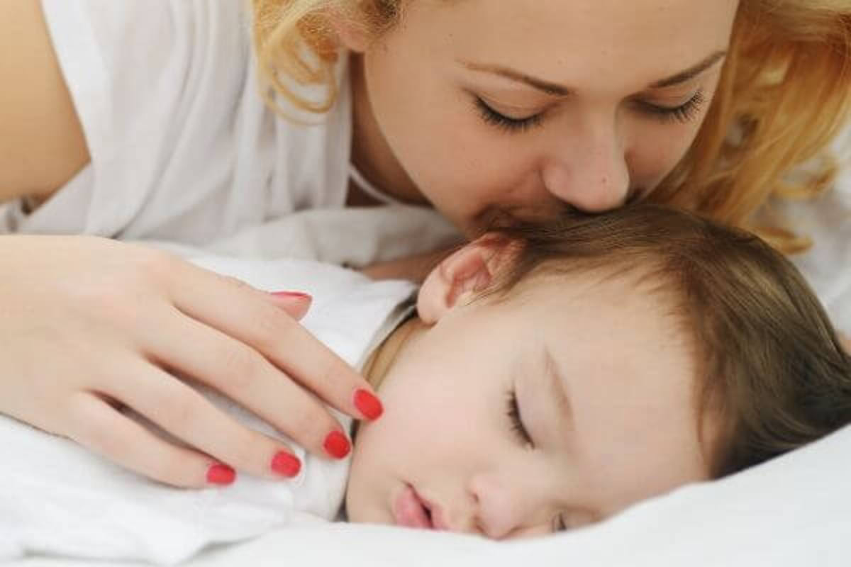 Mom-Kissing-Sleeping-Child-2