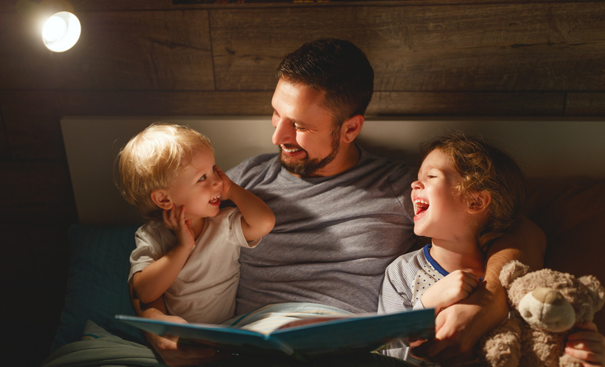 bigstock-Evening-Family-Reading-Father-235568905